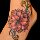 Flower tattoo on a woman's foot