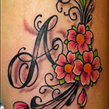 Flowers And Lettering Tattoo