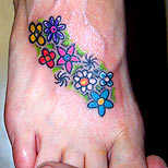 Flowers tattoo on a girl's foot