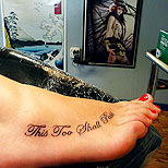 Quote tattoo on foot: This too shall pass