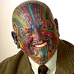 Man with a full face tattoo (Maori style)