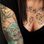Girl with a Chinese dragon and flower tattoo