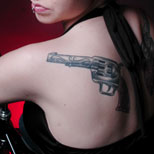 Girl with a gun tattoo