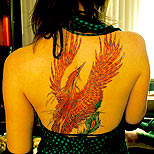 Girl with a phoenix tattoo on her back