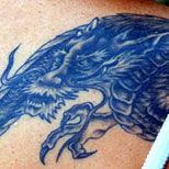 Girl with a blue dragon tattoo on her back
