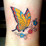 Girly butterfly and flowers tattoo