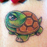 Girly turtle tattoo