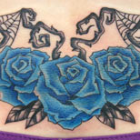 Gothic blue roses tattoo on lower back
