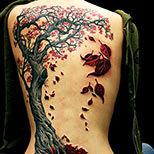 Tree tattoo with heart and red leaves