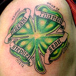 Irish clover tattoo on a man's upper arm