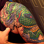 Japanese dragon tattoo design on man's upper arm