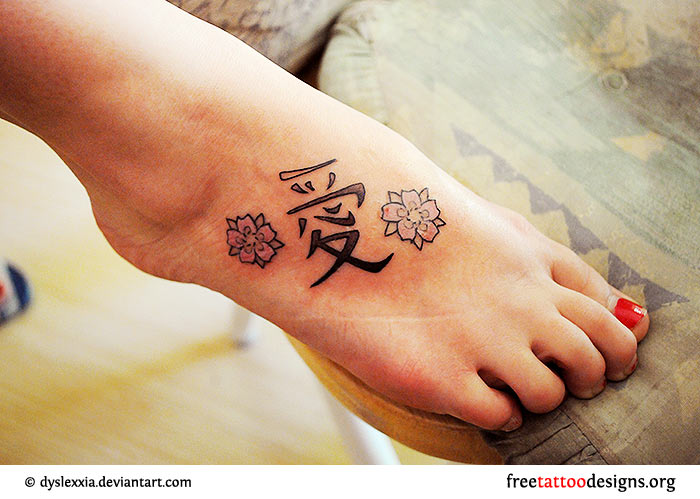 29209ba7f4c37 Butterfly tattoo on foot · Swirly flowers on foot · Kanji and flowers on  foot