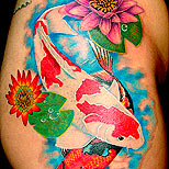 Koi fish and lotus tattoo