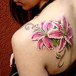 Lilies tattoo on a girl's shoulder