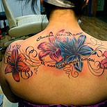 Lilies tattoo on a woman's back