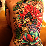 Geisha with a lotus flower, tree and Japanese waves