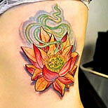 Lotus tattoo on a girl's side