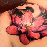 Lotus tattoo on a woman's shoulder