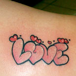 Love and hearts tattoo