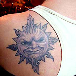 Man with a sun tattoo on his shoulder