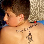 Boy with a misspelled tattoo on his back