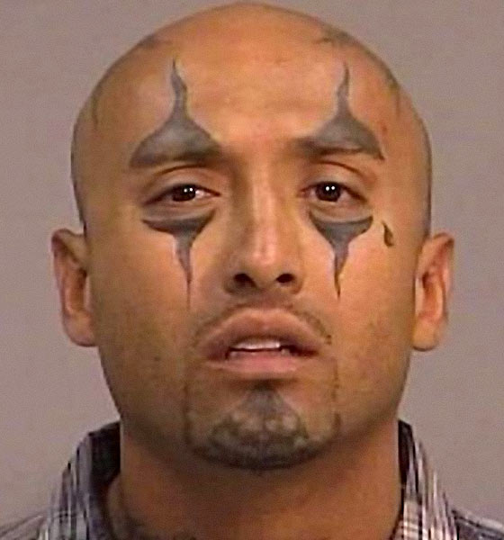 ... Gang member with face tattoos