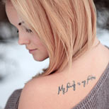 My family is my fortress tattoo on a girl's back