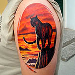 Panther and landscape tattoo