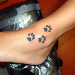 Paw print tattoo on ankle