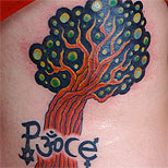 Peace, ohm and tree tattoo