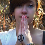 Peace sign tattoo on a girl's hands
