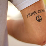 Peace sign tattoos on a man's arm