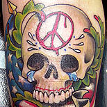 Peace skull tattoo