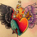 Pierced winged heart tattoo