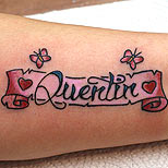 Pink banner tattoo with name and small butterflies