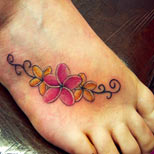 Plumeria tattoo on foot