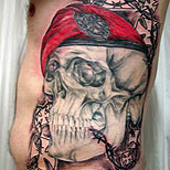 Army skull tattoo and prick wire