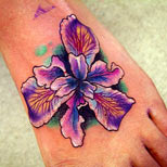 Purple flower design on foot