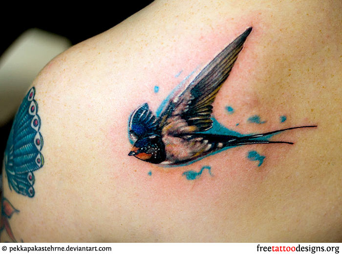 9fe553b5ce8a0 Red swallow tatoo on a man's arm, Realistic swallow tattoo ...