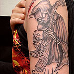 Grim Reaper tattoo on a man's arm