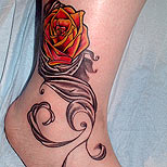 Red rose tattoo on ankle