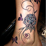 Rose tattoo with butterflies on ankle
