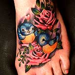 Rose foot tattoo with 2 birds