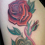 Red rose and locket tattoo