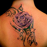 Purple rose and stars tattoo on a woman's back