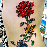 Man with a roses tattoo on his side