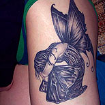 Sad fairy tattoo on a girl's leg