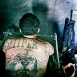 Marine with a Semper Fi and lion tattoo on his back