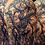Skeleton in tree tattoo