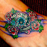 Skull and roses tattoo on foot
